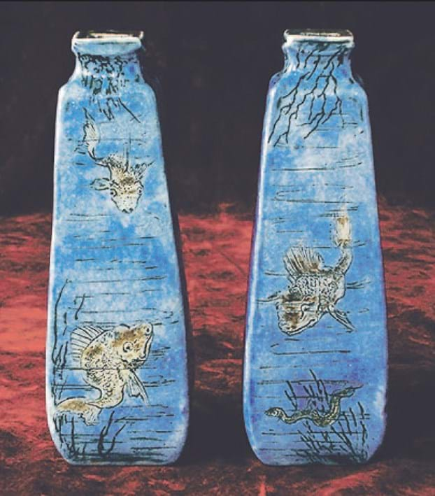 Martin Brothers vases incised with fish, jellyfish and an eel.